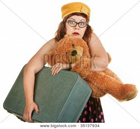 Tense Young Woman With Suitcase