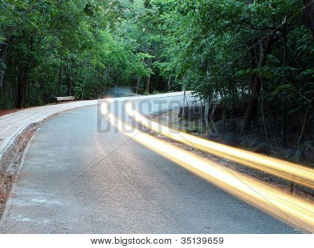 Cars Pass On A Country Road