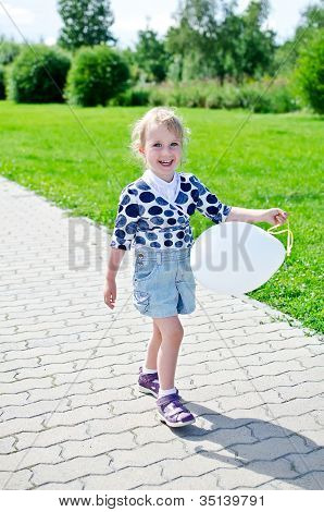 Smiling Little Girl With Balloon In The Park.