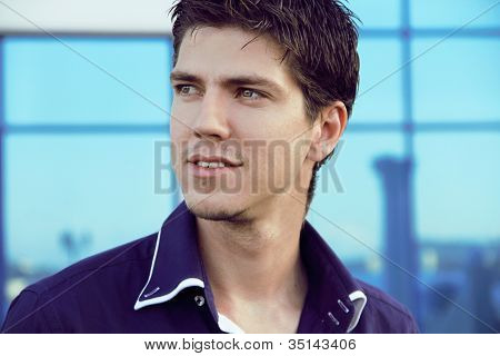 Closeup Portrait Of Happy Young Man Looking At Something Interesting - Copyspace