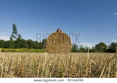 Man Lying On A Hay Bales