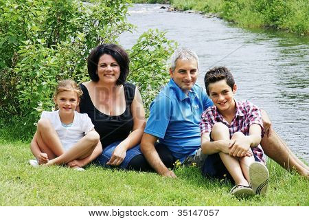 Family By The River