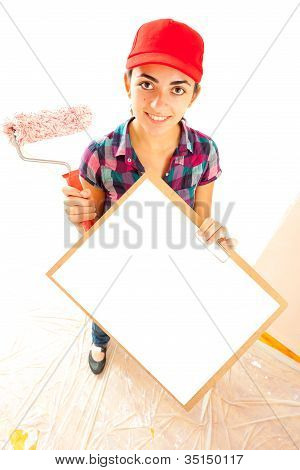 Woman Painter With Roll Brush And Clipboard