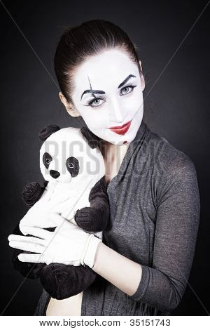 A Woman Mime With A Toy Panda