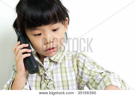 Child Speaking On The Phone
