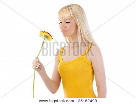 Attractive Blonde Woman Smelling Daisy