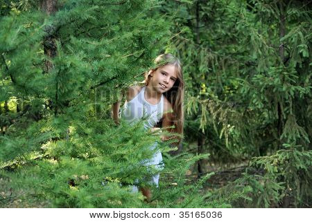 Girl Looking Out From Behind Tree