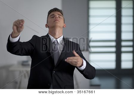 Businessman Conducting His Work And Business With His Baton