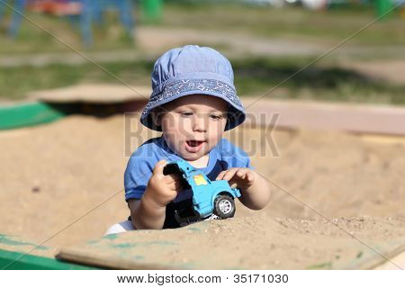 Child Playing With Toy Car