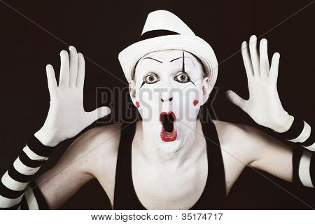 Ape Mime In Striped Gloves And White Hat
