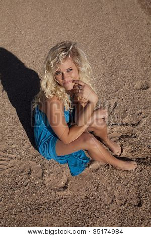 Woman Blue Dress Sit Sand Look Up