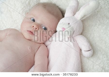 Cute Baby Cuddling With Pink Toy Bunny Blanket