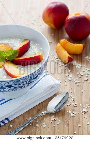 Oatmeal porridge with nectarines
