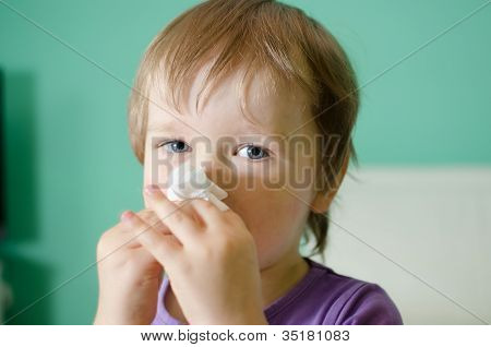 Little Boy Cleaning Nose