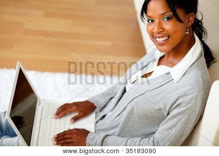 Young Woman With Her Laptop Smiling At You