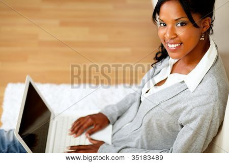 Beautiful Woman Smiling At You With Her Laptop