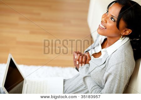 Young Black Woman Sitting At Home On The Floor