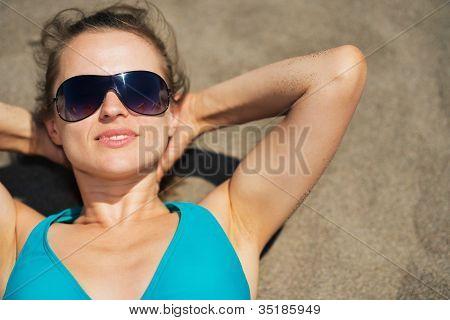 Woman Laying On Beach Sand