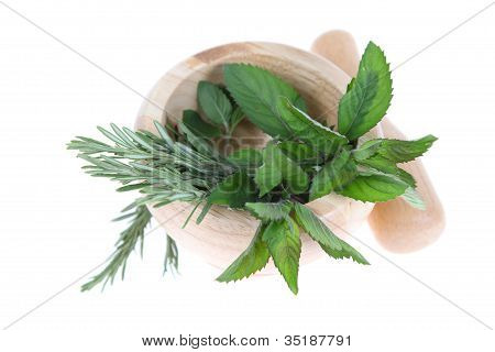 Rosemary And Mint In A Wooden Pounder