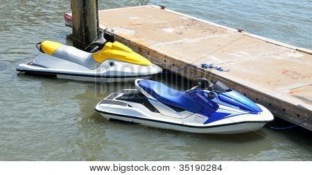Jet Skis moored on a dock