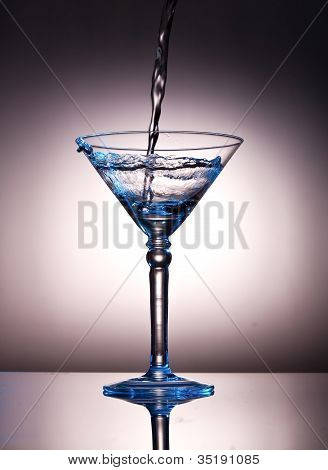 Pouring Liquor Into A Martini Glass