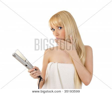 Woman With Hair Straighteners Looking Surprised