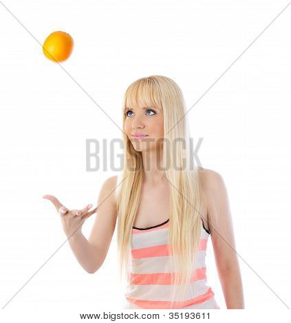 Young Woman Tossing Up Orange