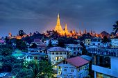 stock photo of yangon  - Shwedagon pagoda highlighted impressively in Yangon Burma - JPG