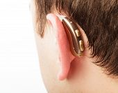 stock photo of aerophone  - Hearing aid on the man - JPG