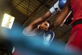 stock photo of pugilistic  - Sport and people two men exercising and fighting in boxing gym - JPG