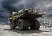 stock photo of wheel loader  - Heavy mining truck driving along the opencast - JPG