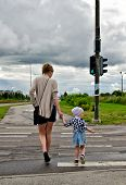 Mother And Little Daughter On Zebra Crossing