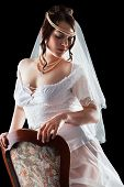 stock photo of underskirt  - Lovely sensual bride in modern lingerie on black background - JPG