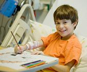 stock photo of feeling better  - Little Boy in Hospital Feeling Much Better - JPG