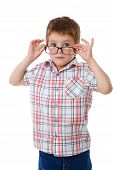 Surprised little boy in glasses
