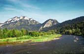 pic of pieniny  - Mountains landscape with river rafting green grass trees and clouds - JPG