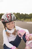 Lovely Portrait Of Cute Smiling Blond Caucasian Girl With Rollerblades
