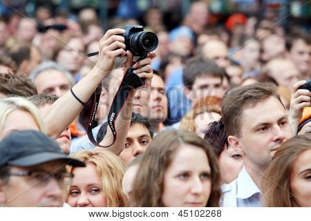 MOSCOW - JUN 23: People at concert of Chaif rock-band during VII traditional festival of live sound Music of Summer in Hermitage Garden, Jun 23, 2012, Moscow, Russia.