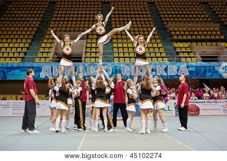 MOSCOW - MAR 24:  Cheerleaders girl team performs stunt at Championship and Contests of Moscow in cheerleading at Palace of Sports Dynamo, March 24, 2012, Moscow, Russia.