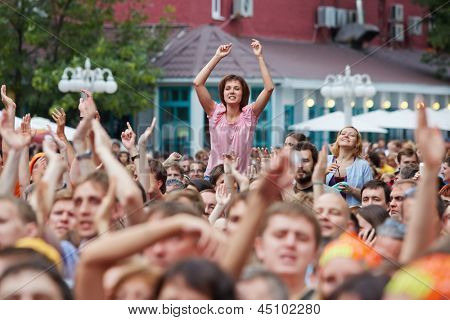 MOSCOW - JUN 23: People welcome Chaif rock-band at outdoor performance stage during VII traditional festival of live sound Music of Summer in Hermitage Garden, Jun 23, 2012, Moscow, Russia.