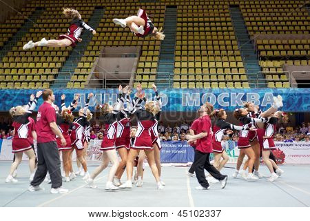 MOSCOW - MAR 24: Team of participants performs at Championship and Contests of Moscow in cheerleading at Palace of Sports Dynamo, March 24, 2012, Moscow, Russia.