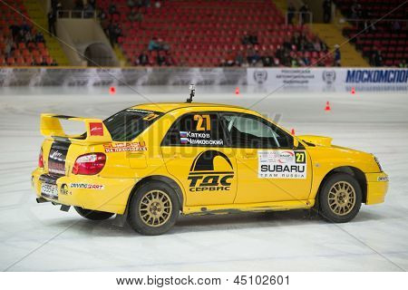 MOSCOW - APR 21: Katkov and Tchaikovsky in racing car on ice in sports complex Krylatsky, on Rally Masters Show, on April 21, 2012 in Moscow, Russia