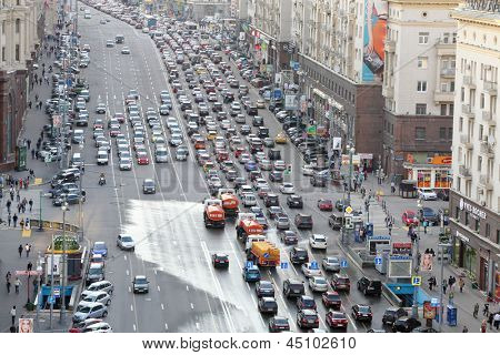 MOSCOW - MAY 15: Traffic jam on Tverskaya st. and watering machines, on May 15, 2012 in Moscow, Russia. Moscow Mayor Sobyanin building roads to solve problem of traffic jams in 2016