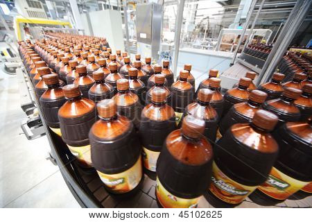 MOSCOW - MAY 16: Many beer bottles in Ochakovo factory, on May 16, 2012 in Moscow, Russia. Ochakovo was founded in 1978.