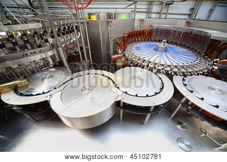 MOSCOW - MAY 16: Beer bottles ready for filling in Ochakovo factory, on May 16, 2012 in Moscow, Russia. Ochakovo was founded in 1978.
