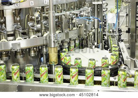 MOSCOW - MAY 16: Cans mojitos on conveyor in Ochakovo factory, on May 16, 2012 in Moscow, Russia. Ochakovo has breweries in several Russian cities - Moscow, Krasnodar, Tyumen, Penza.