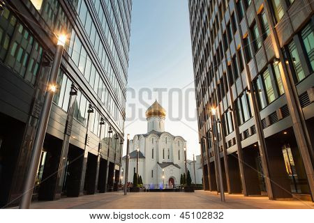 MOSCOW - AUG 27: Old church between two office buildings at sunset near the Office Center White Square in the evening on August 27, 2011, Moscow, Russia.