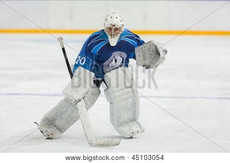 MOSCOW - APR 28: Hockey goalie ready to catch puck on closing ceremony of the championship season of 2011-2012 Ice Hockey for Sports School, junior teams on April 28, 2012, Sokolniki, Moscow, Russia.