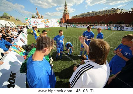 MOSCOW - MAY 26: Football players listen to coach on VIII Forum Ready for Labor and Defense on May 26, 2012 in Red Square, Moscow, Russia.
