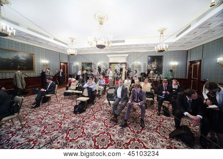 MOSCOW - APRIL 24: Newspapermans sit on Enlarged meeting of Council in Grand Kremlin Palace on April 24, 2012 in Moscow, Russia.